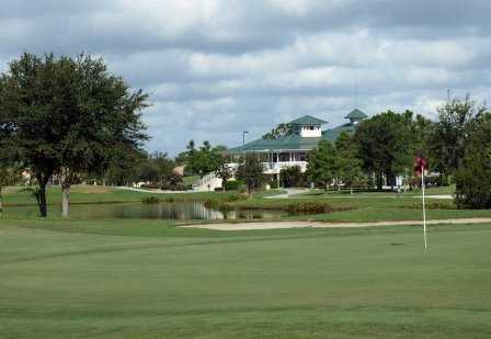 A view of green with clubhouse in background at The Preserve Golf Club