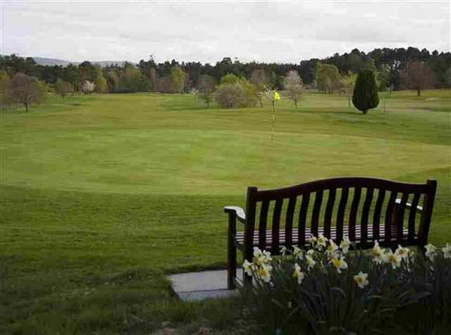 Bench beside the green at Forres GC