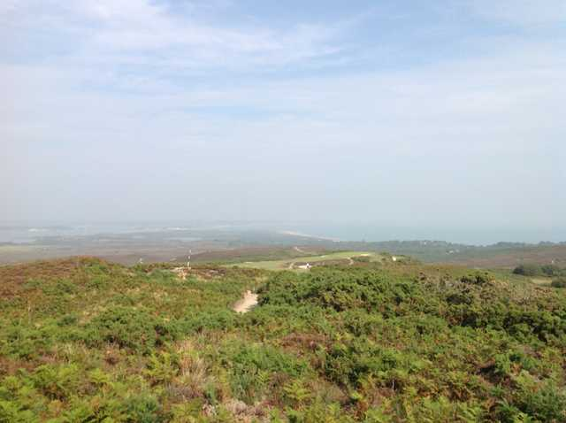 A scenic view of the 3rd hole with the sea in the horizon at  Isle of Purbeck Golf Club