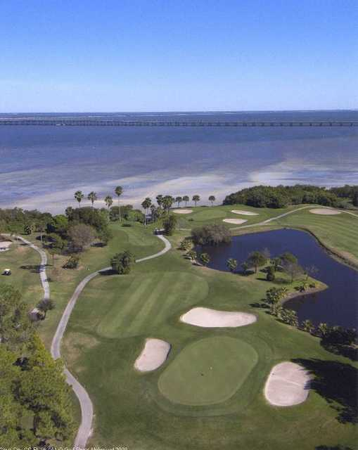 Aerial view of a green protected by bunkers at Cove Cay Golf Club
