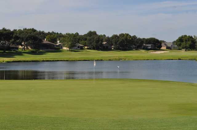 A view of a green with water in background at Green Valley Country Club.