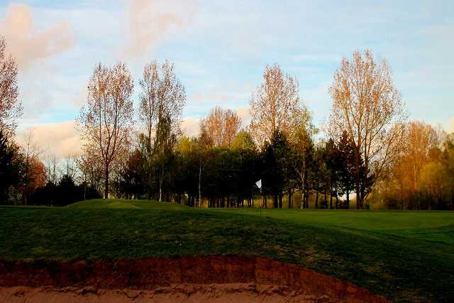 A view of the putting green from the bunker