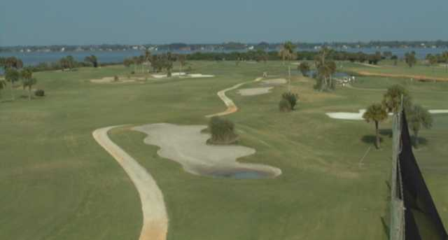 A view of a fairway with water in background at Cocoa Beach Country Club