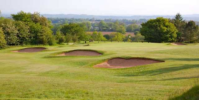 The bunker-guarded 16th green at The Mendip Golf Club