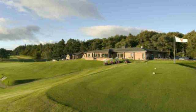 1st hole with the clubhouse at West Linton Golf Club