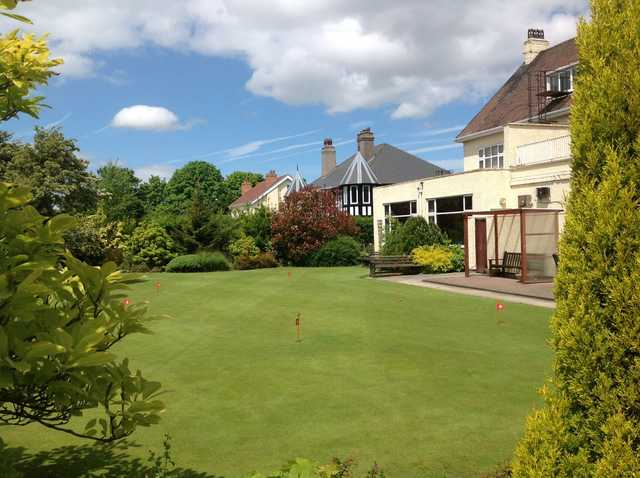 The clubhouse and putting green at Runcorn Golf Club