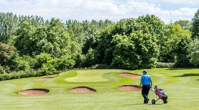 The bunker-guarded 6th green on the Stoneleigh Deer Park Golf Course