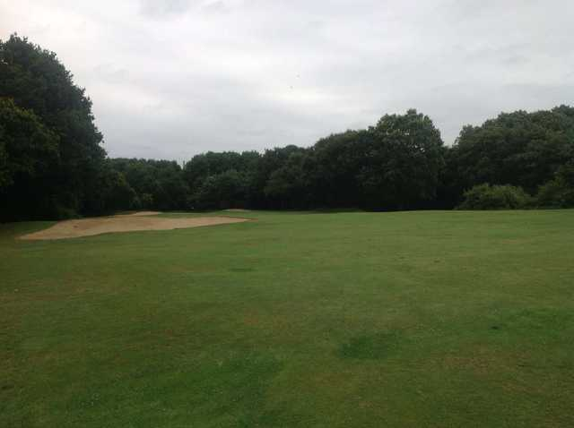 Approach to the bunker-guarded 1st green on the West Middlesex Golf Course