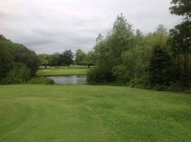 A shot over the lake required to hit the 11th green on the West Middlesex Golf Course