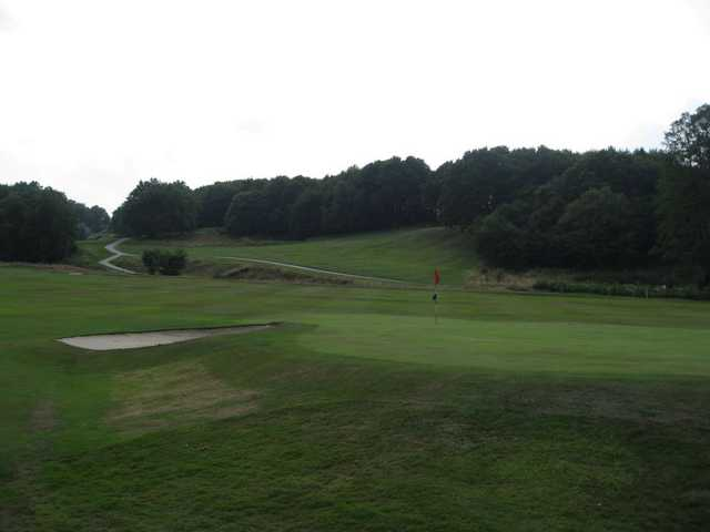 A view of the 18th green and greenside bunker at Greenway Hall Golf Club