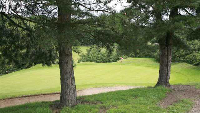 A view of the course through trees at Deane GC