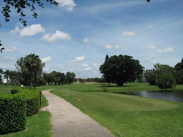 A view of the 18th green with clubhouse in background at Poinciana Country Club