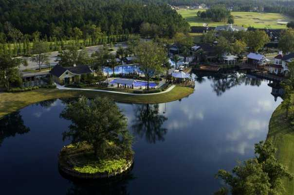 Aerial view of swim park, pool & lakeside cabana bar and residents club at Eagle Landing