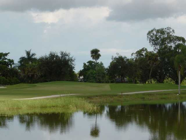 A view over the water of green #8 at Hibiscus Golf Club