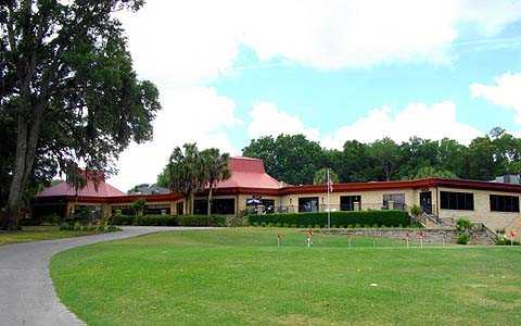 A view of the putting green with clubhouse in background at Country Club of Silver Springs Shores