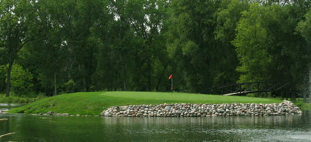A view of a green surrounded by water at Silver Spring Country Club