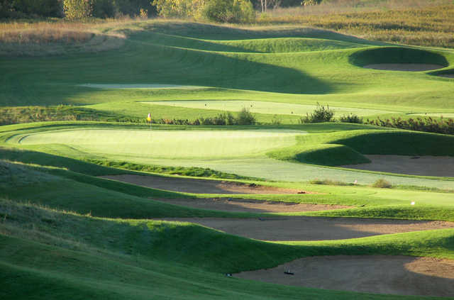A sunny day view of a green at Highlands of Elgin