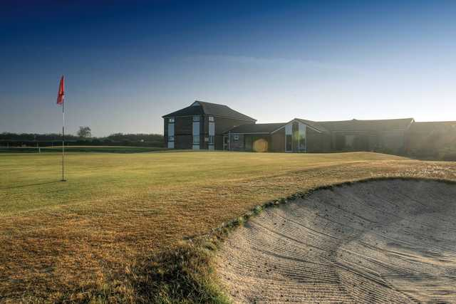 View of a green and clubhouse at Holsworthy Golf Club