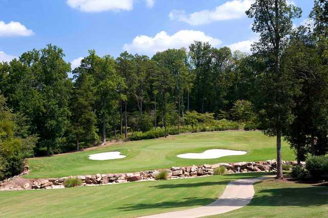 A view of a green protected by bunkers from Golf Club at Ballantyne