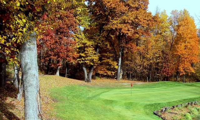 A fall day view of a hole at Myth Golf & Banquet