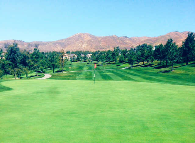 A sunny day view of a green at Yucaipa Valley Golf Club