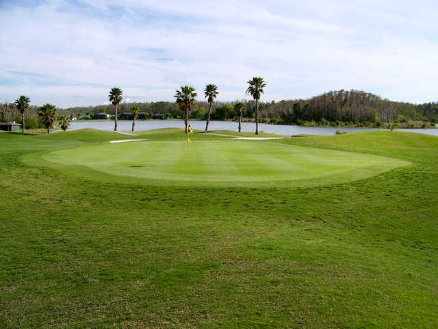 A view of the 18th green with water in background at EastWood Golf Course