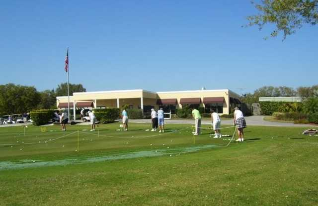 A view of the clubhouse and practice area at Serenoa Golf Club