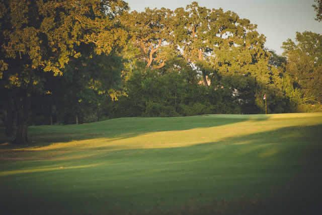 Sunset view of a green at City Course at The Phillips Event Center