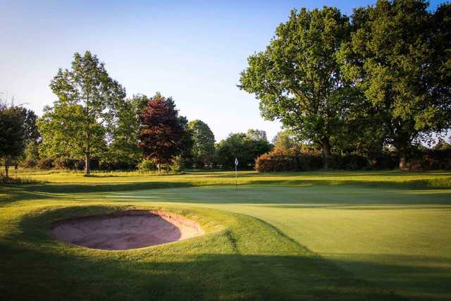 View of a green and bunker at Henley Golf Club
