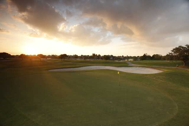 Sunset on a green at Heron Bay Golf Course