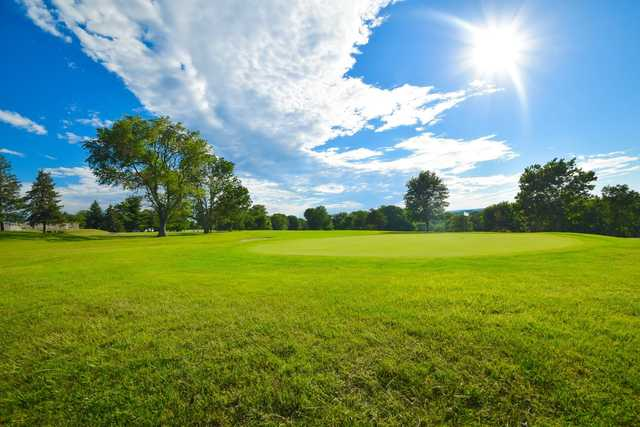A sunny day view of a green at Hillsborough Country Club.