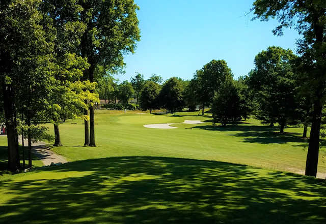 A sunny day view of a hole at Bedford Hills Golf Club.