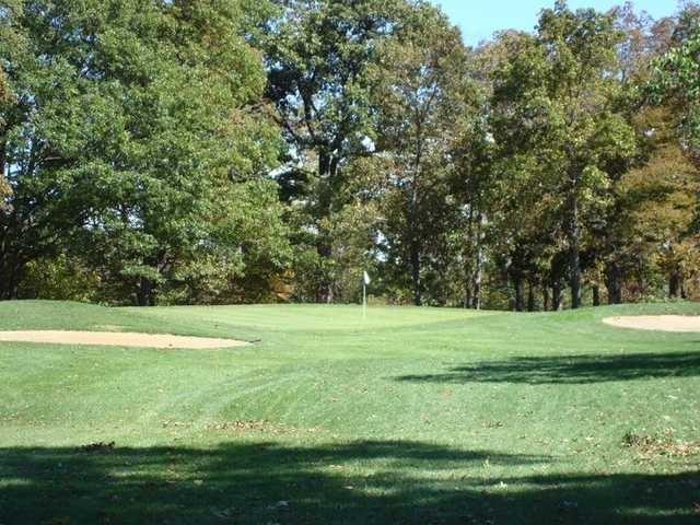 A view of green with bunkers on sides at Auglaize Golf Club