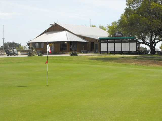 A view of the 18th green with clubhouse in background at Delaware Springs Golf Course