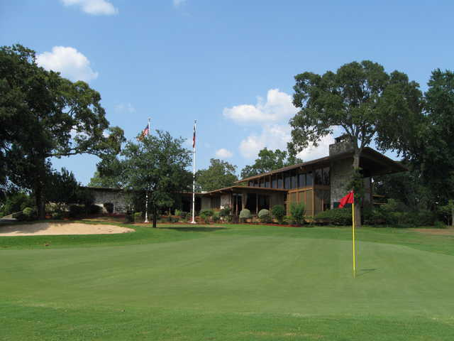 A view of the clubhouse with a green in foreground at Panorama Golf Club