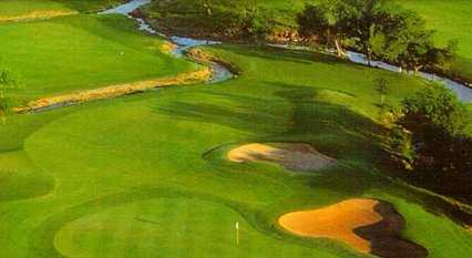 Aerial view of a green protected by bunkers at The Trails of Frisco Golf Club