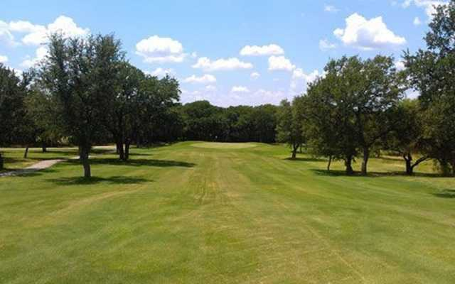 A view from a fairway at Hidden Oaks
