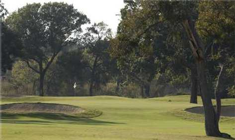 A view of a green protected by bunkers at Grand Oaks Golf Club