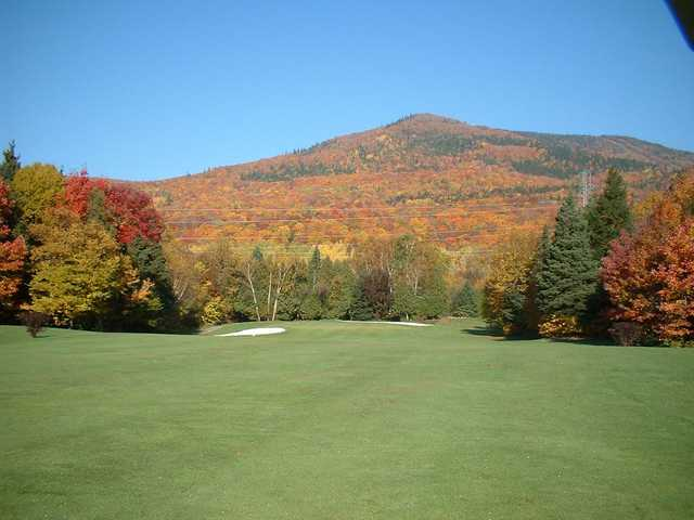A fall day view from a fairway at Le Grand Vallon.