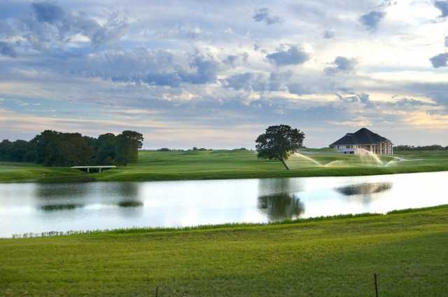 A view over the water of the 18th hole at The Bridges Golf Club