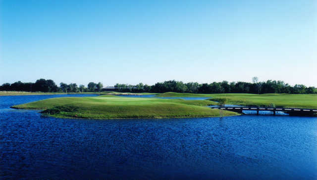 A view of the 12th green surrounded by water at Lakes Course from Wildcat Golf Club