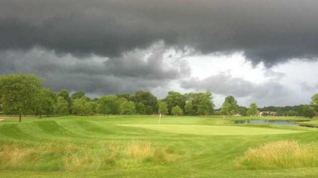 A view of storm clouds over a green at Wildcat Creek Golf Course.