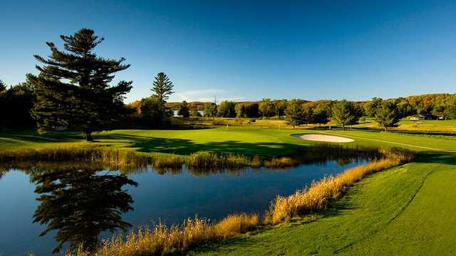 A view of a green with water coming into play at Alpine Resort & Golf.