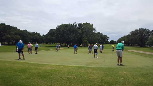 A view of the practice putting green and a fairway in the distance at A. C. Read Golf Course.