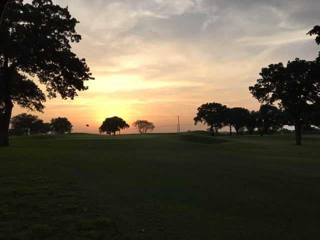 A sunset view of a hole at Graham Country Club.