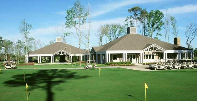 A view of the putting green with clubhouse in background at Eagle Pointe Golf Club