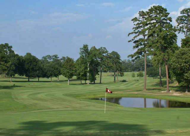 A view of a green with water coming into play at Piney Woods Country Club.