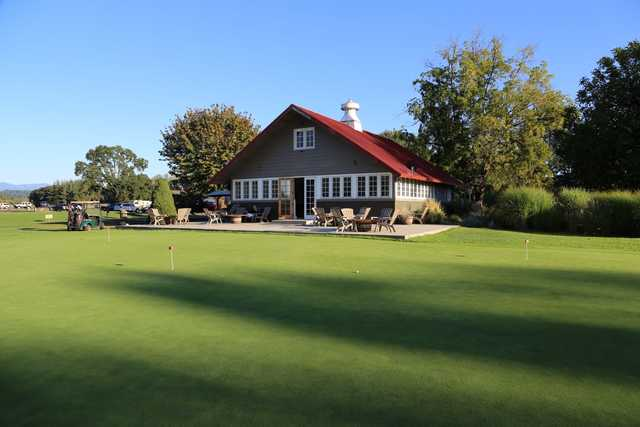 View of the putting green and clubhouse at Eagle Creek Golf Course