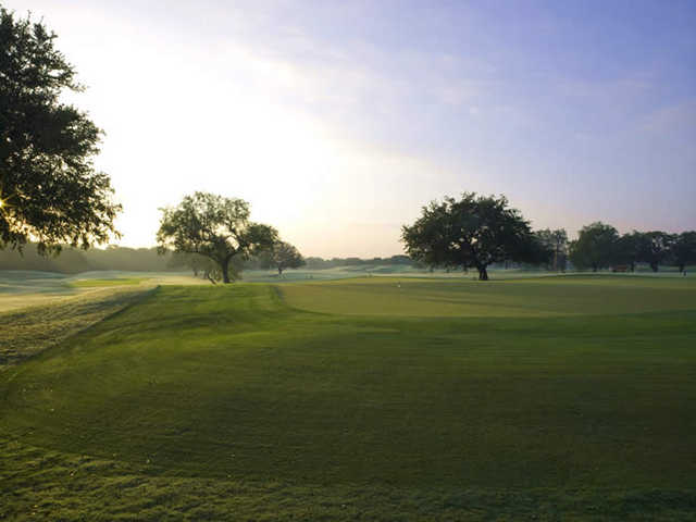 A view of the putting green at Hill Country Golf Club