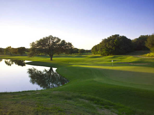 A view of a green with water coming into play from left at Hill Country Golf Club